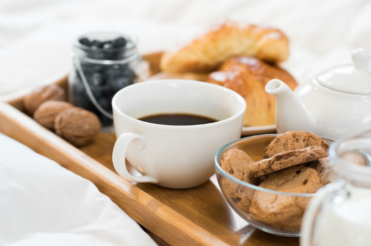bigstock-Breakfast-in-bed-with-hot-coff-125868122