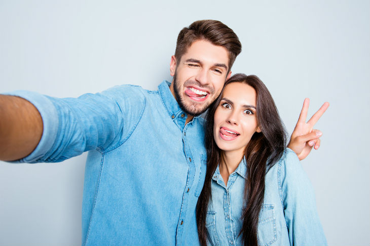 bigstock-Funny-Couple-Showing-Tongues-A-153865997