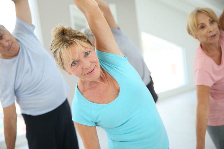 bigstock-Senior-people-stretching-out-i-102394619
