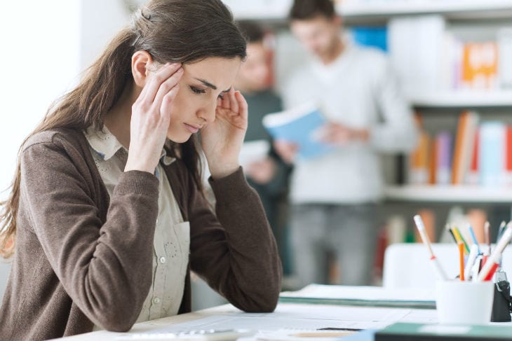 bigstock-Young-Student-With-Headache-116751416