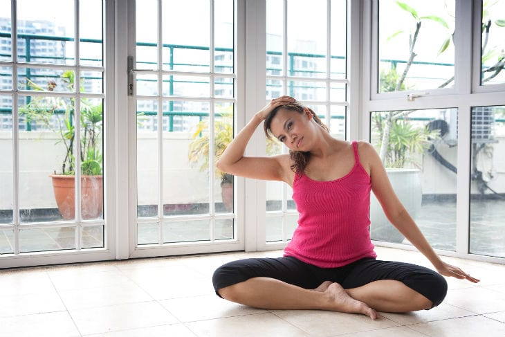 bigstock-Young-fitness-woman-stretching-180653601