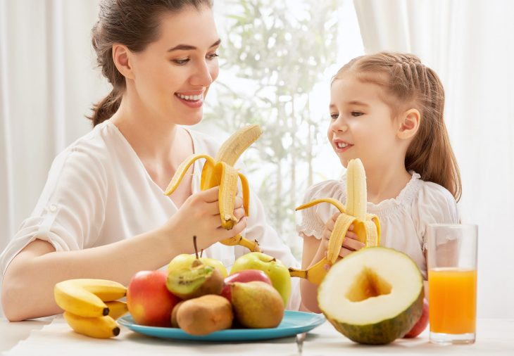 bigstock-happy-family-eating-fresh-frui-84816674