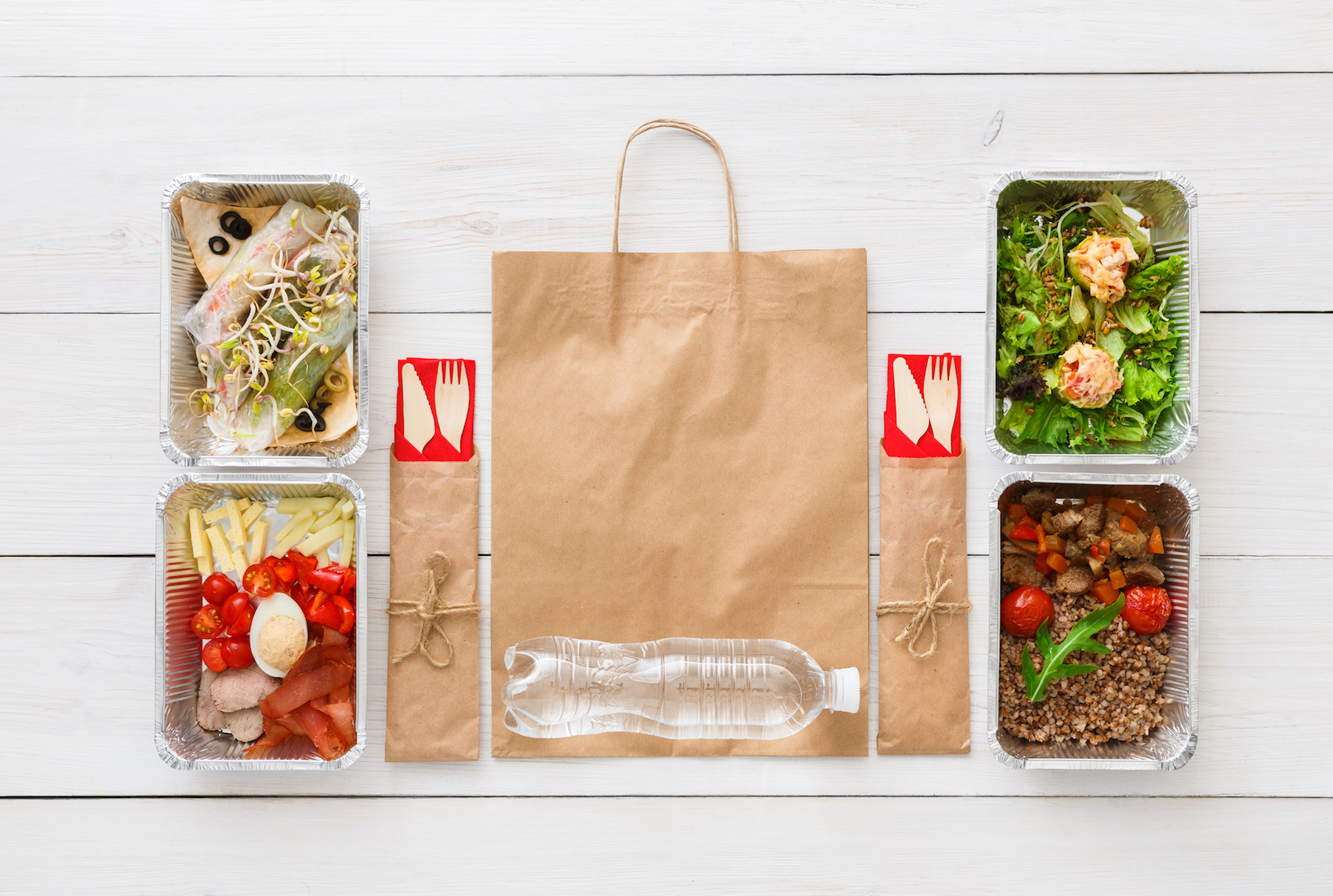 Healthy restaurant food. Chef prepared diet daily meals delivery. Fitness nutrition, vegetables, meat and fruits in foil boxes, cutlery and package. Top view, flat lay, mockup on wood with copy space