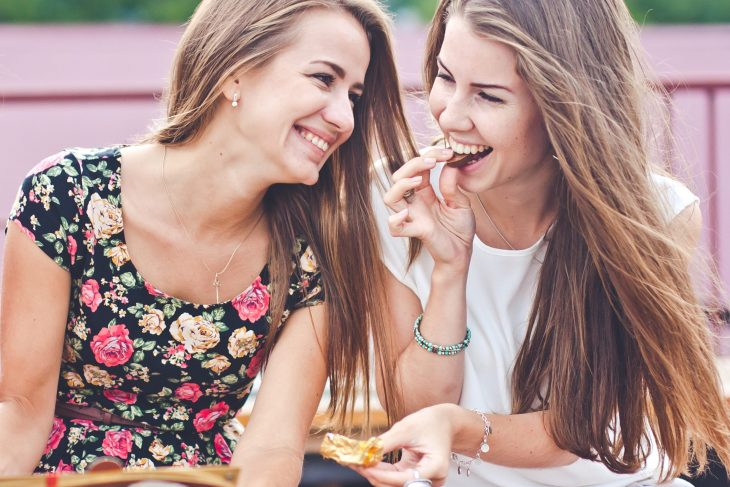 bigstock-Two-young-female-friends-laugh-83990369