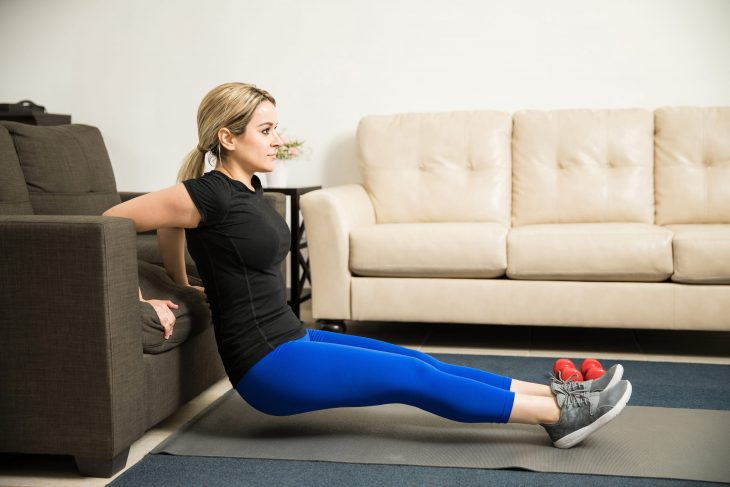 bigstock-Woman-Doing-Tricep-Dips-On-A-C-169949336