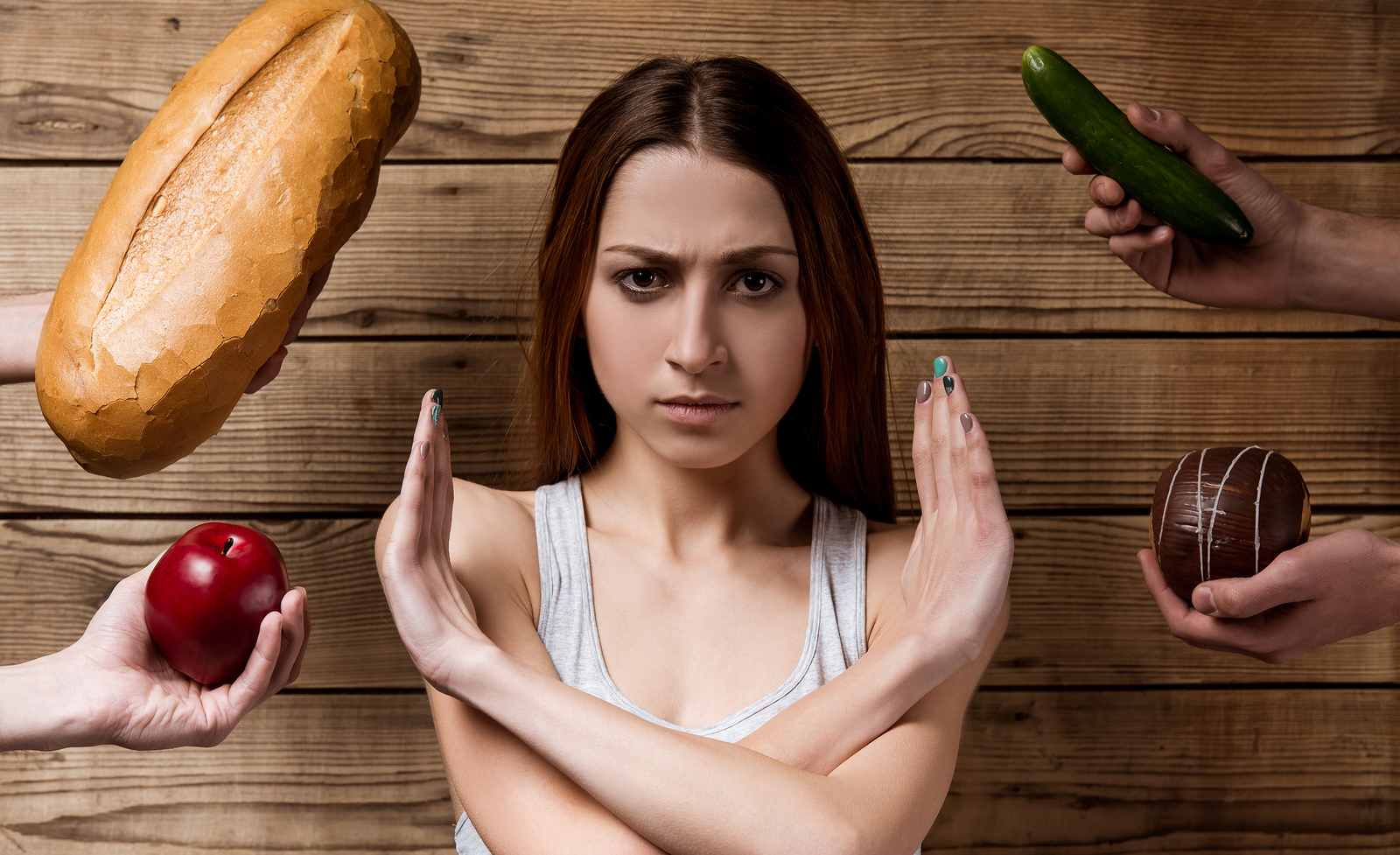 Thin girl in the center refuses food offered from different sides